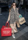 Kelly Brook is all smiles as she arrives bearing Christmas gifts at Global Radio in London, UK