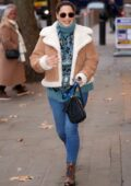 Kelly Brook wears a turtleneck sweater with a fur-lined coat as she arrives at Heart radio in London, UK