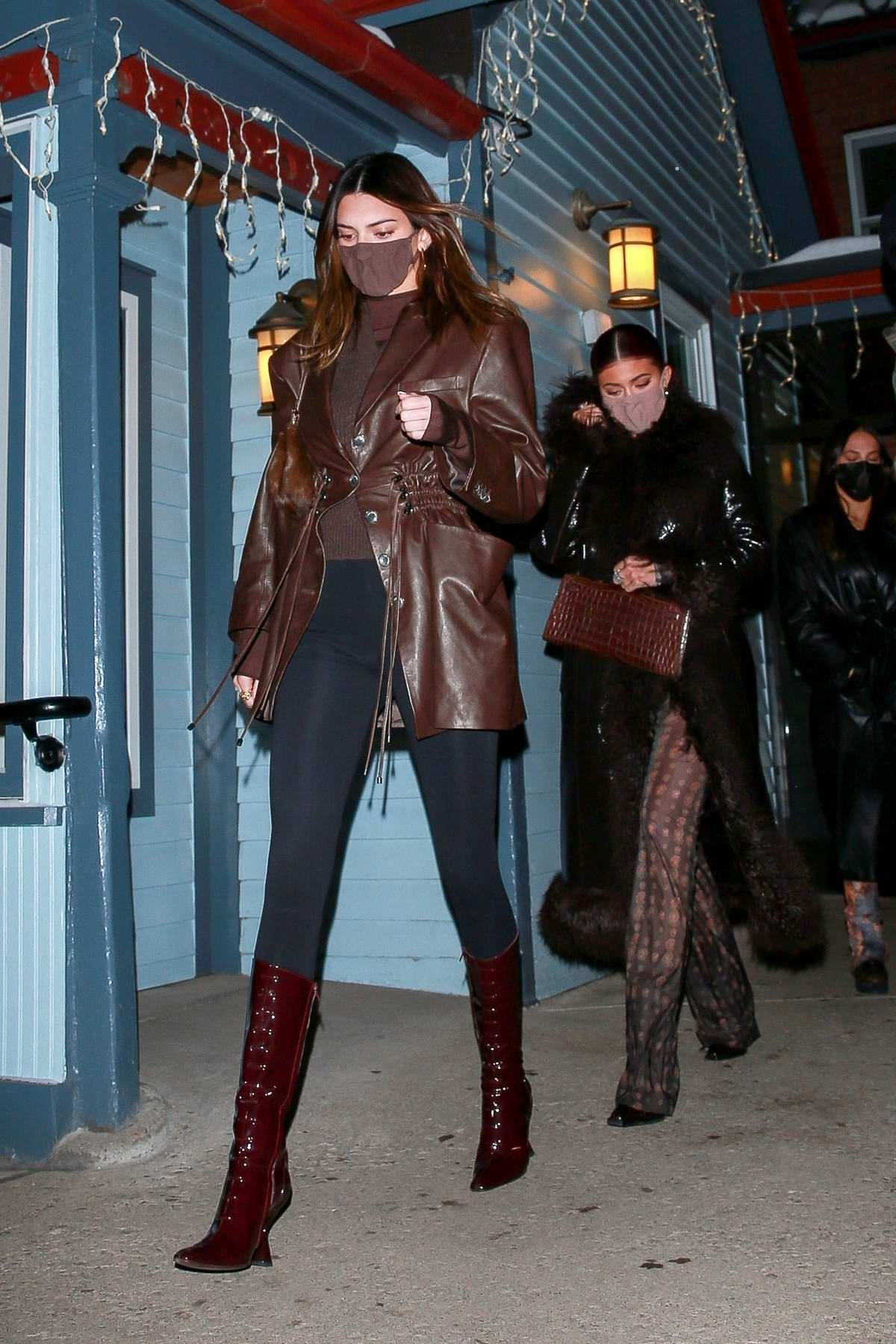 Kendall Jenner and Kylie Jenner keep it stylish as they step out for dinner with their mother Kris in Aspen, Colorado