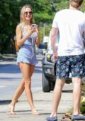 Kimberley Garner looks flawless in a blue floral print romper while out enjoying some fresh coconut water in St James, Barbados