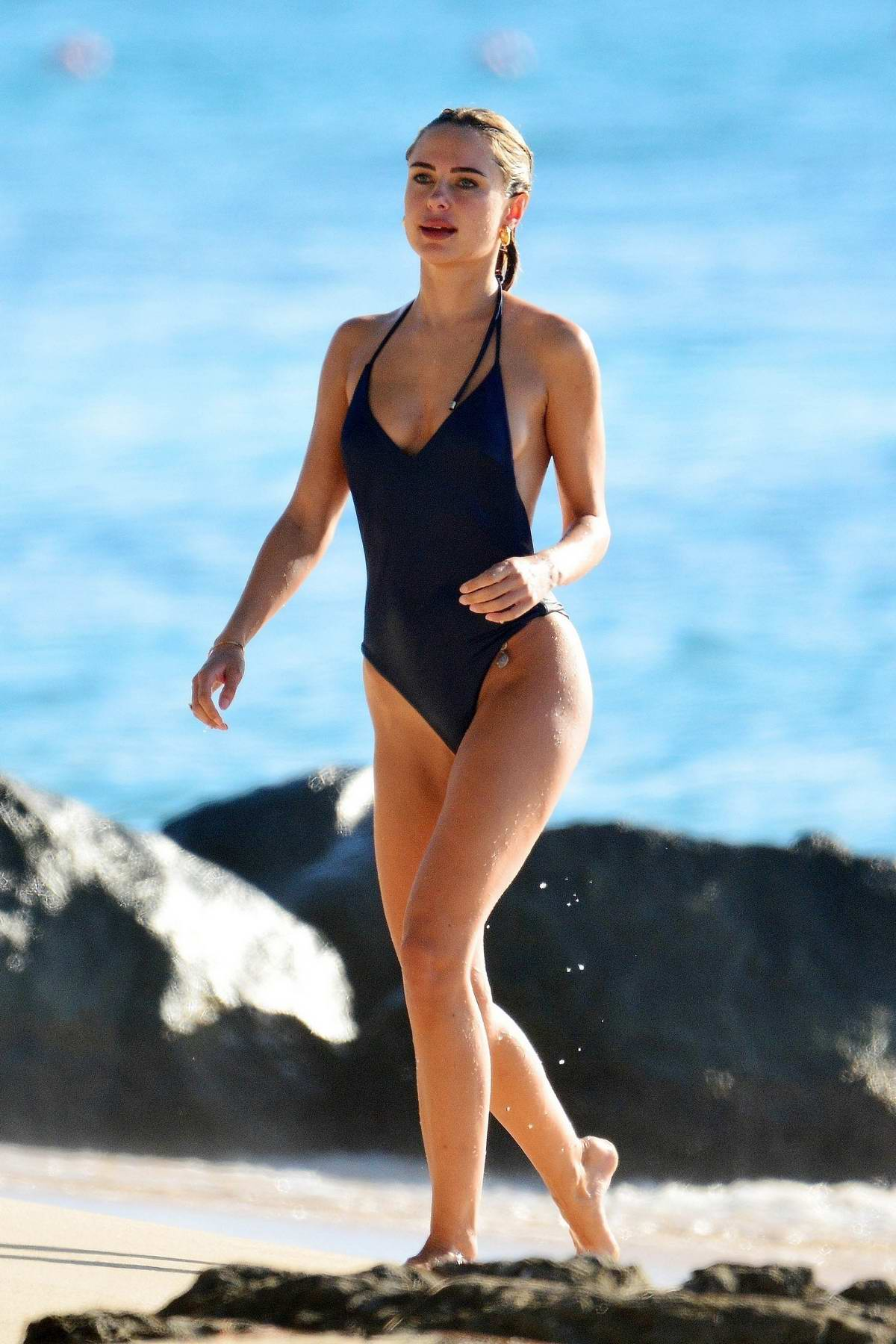 Kimberley Garner scorches the beach in a navy blue swimsuit as she continues her vacation in Barbados