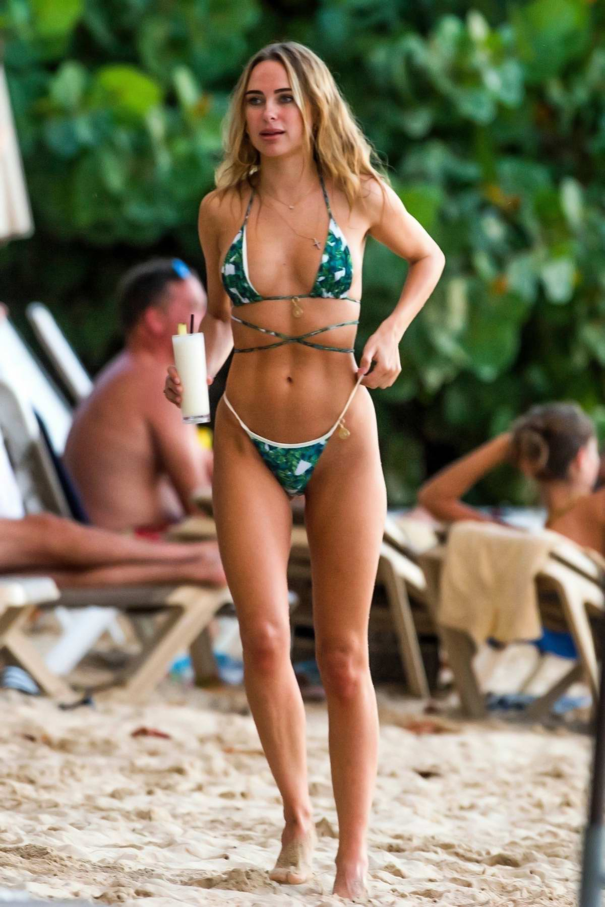Kimberley Garner sizzles in her palm print bikini at the Sea Shed Restaurant's beach at St Peter Parish in Barbados