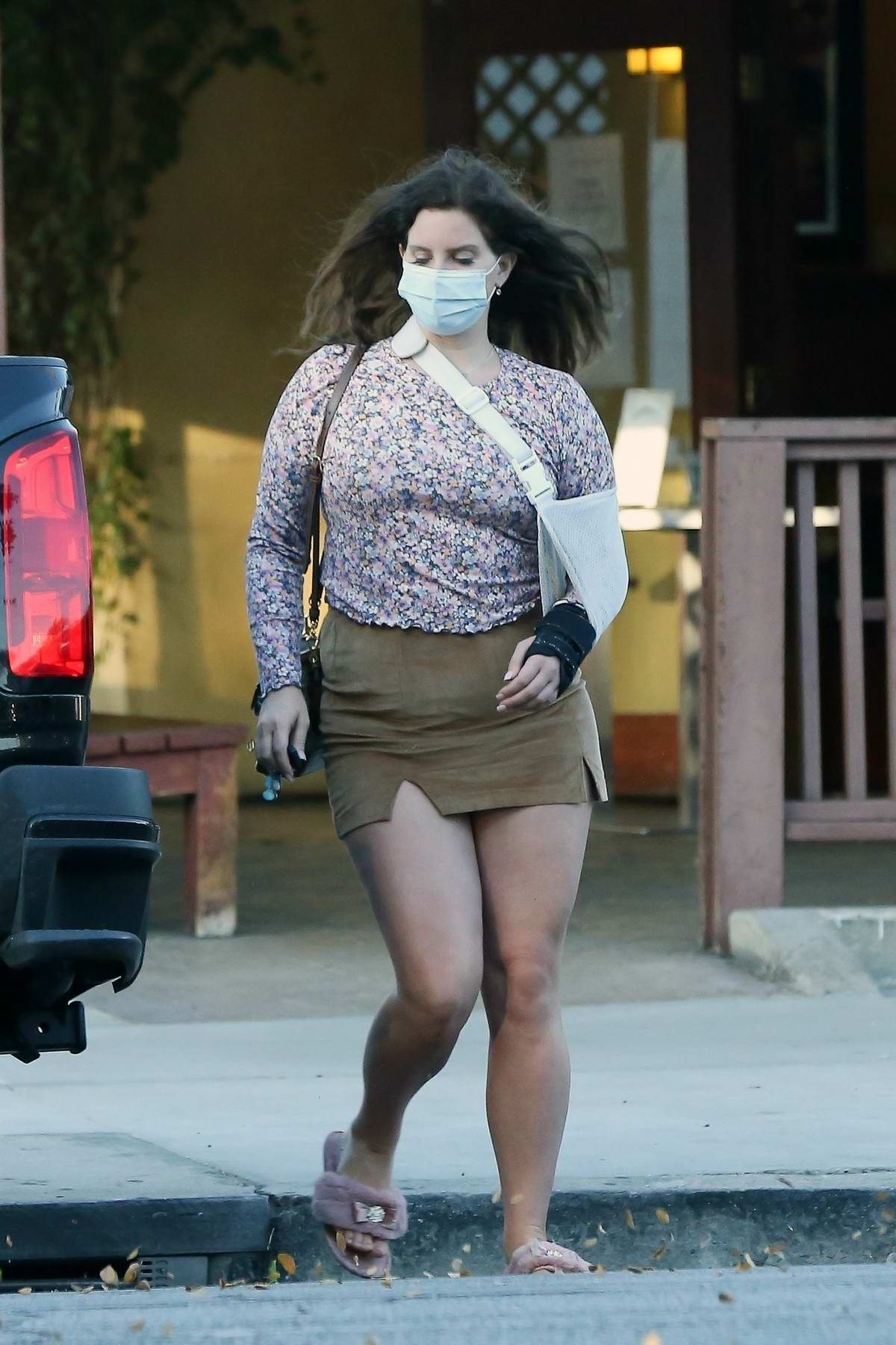 Lana Del Rey dons a mini skirt and a floral long sleeve top while out picking up food in Studio City, California