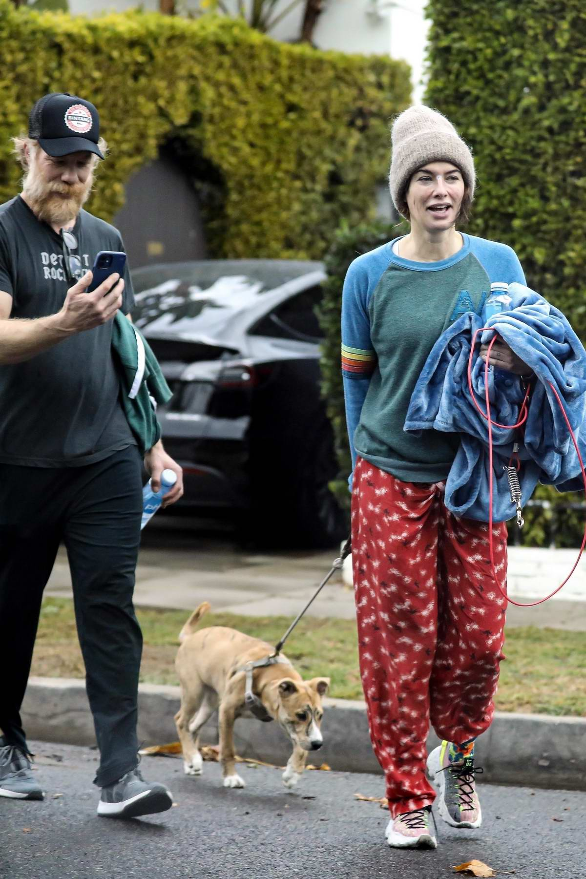 Lena Headey and Marc Menchaca seen leaving a private gym with their puppy in West Hollywood, California