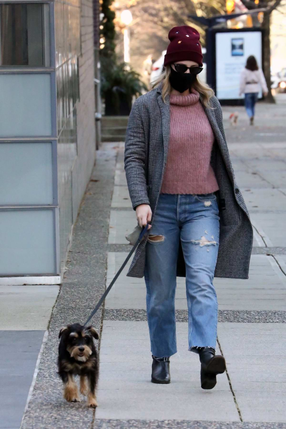 Lili Reinhart looks cozy in a turtleneck with a coat while walking her dog in Vancouver, Canada