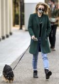 Lili Reinhart looks stylish in an emerald green coat as she goes for a walk with her dog Milo in Vancouver, Canada