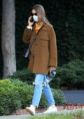 Lily Collins looks cozy while out for a stroll in Beverly Hills, California