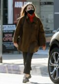 Lily Collins seen running errands and picks up dog food from Tailwaggers in West Hollywood, California