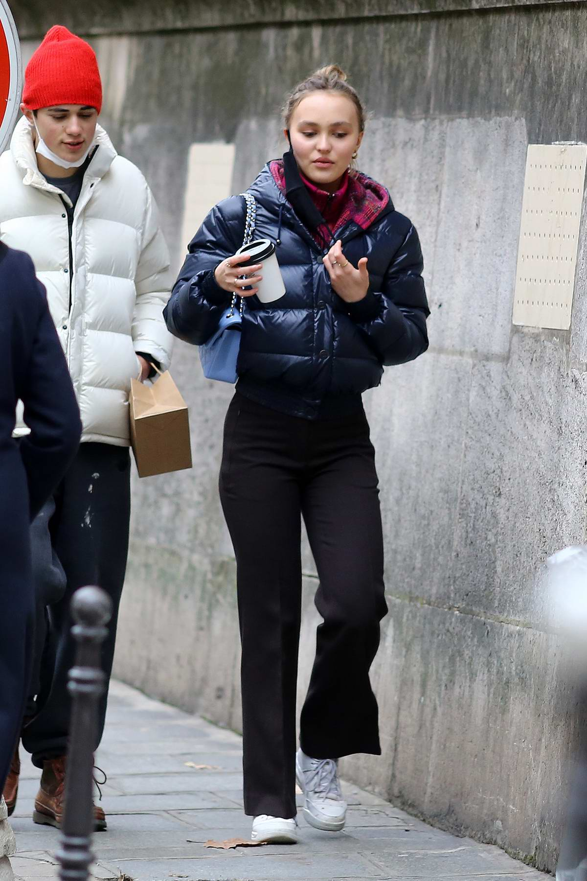 Lily-Rose Depp bundles up in a puffer jacket while out shopping with a male friend in Paris, France