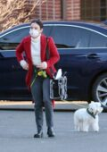 Lucy Hale seen wearing a white turtleneck with a red overcoat while out running errands with her pup in upstate New York