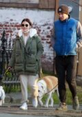 Lucy Hale stays cozy in a green parka with sweatsuit while enjoying a walk with co-star Austin Stowell in Upstate New York