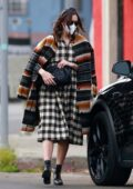 Mandy Moore covers her baby bump in a checkered black and white dress while visiting a friend in Los Angeles