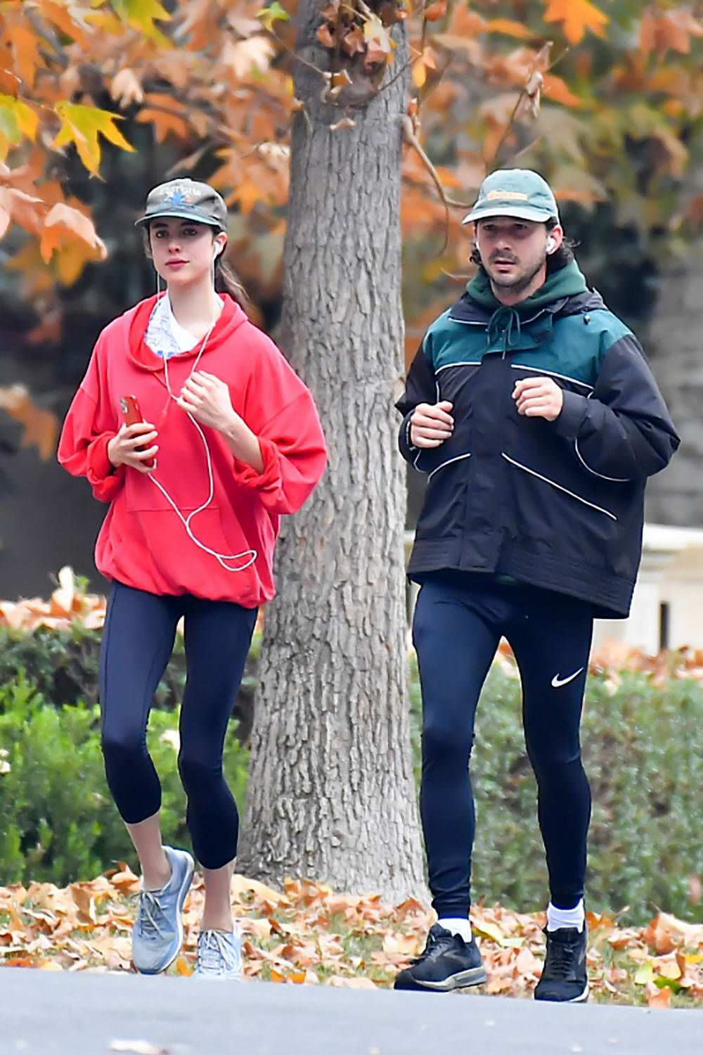 Margaret Qualley and Shia LaBeouf enjoy an early morning run around the neighborhood in Pasadena, California