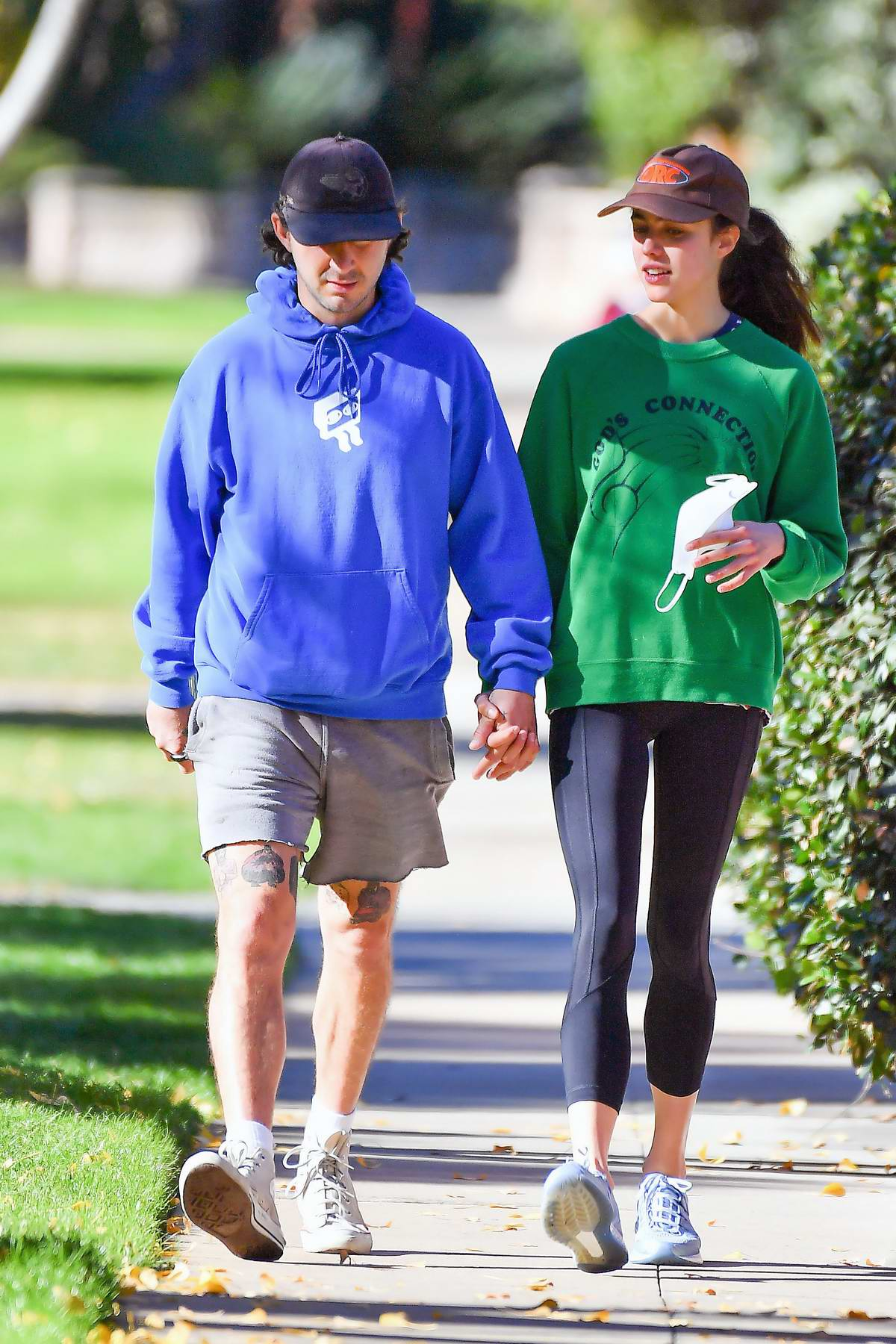 Margaret Qualley and Shia LaBeouf hold hands as they enjoys a stroll at the Huntington Gardens in Pasadena, California