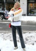 Martha Hunt rocks a fur jacket and leather pants as she poses during a photoshoot in SoHo, New York