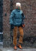 Naomi Watts bundles up in a puffer jacket and a beanie as she braves the first snowfall in New York City