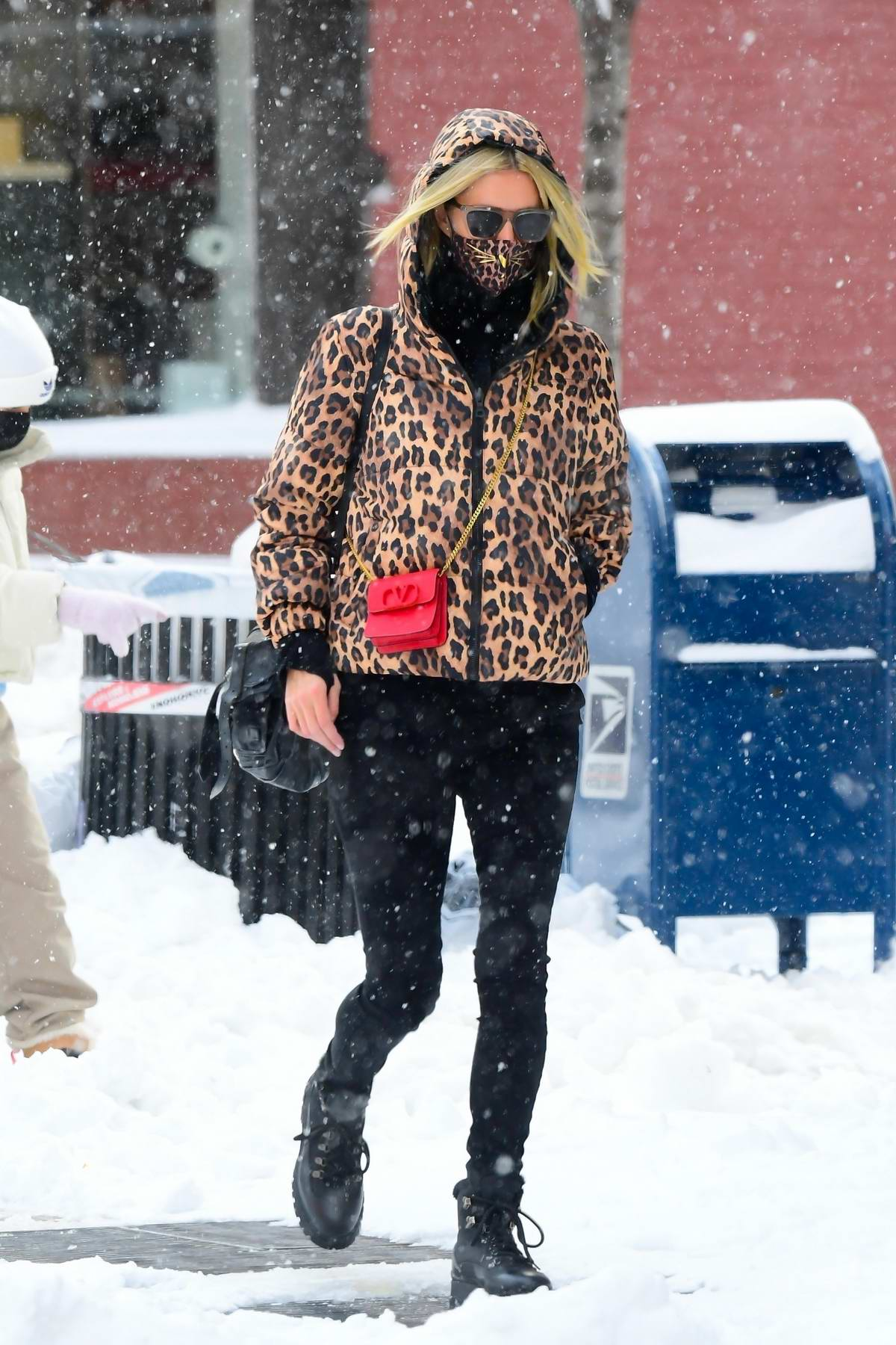 Nicky Hilton wears a leopard print hooded jacket as she steps out on a snowy day in New York City