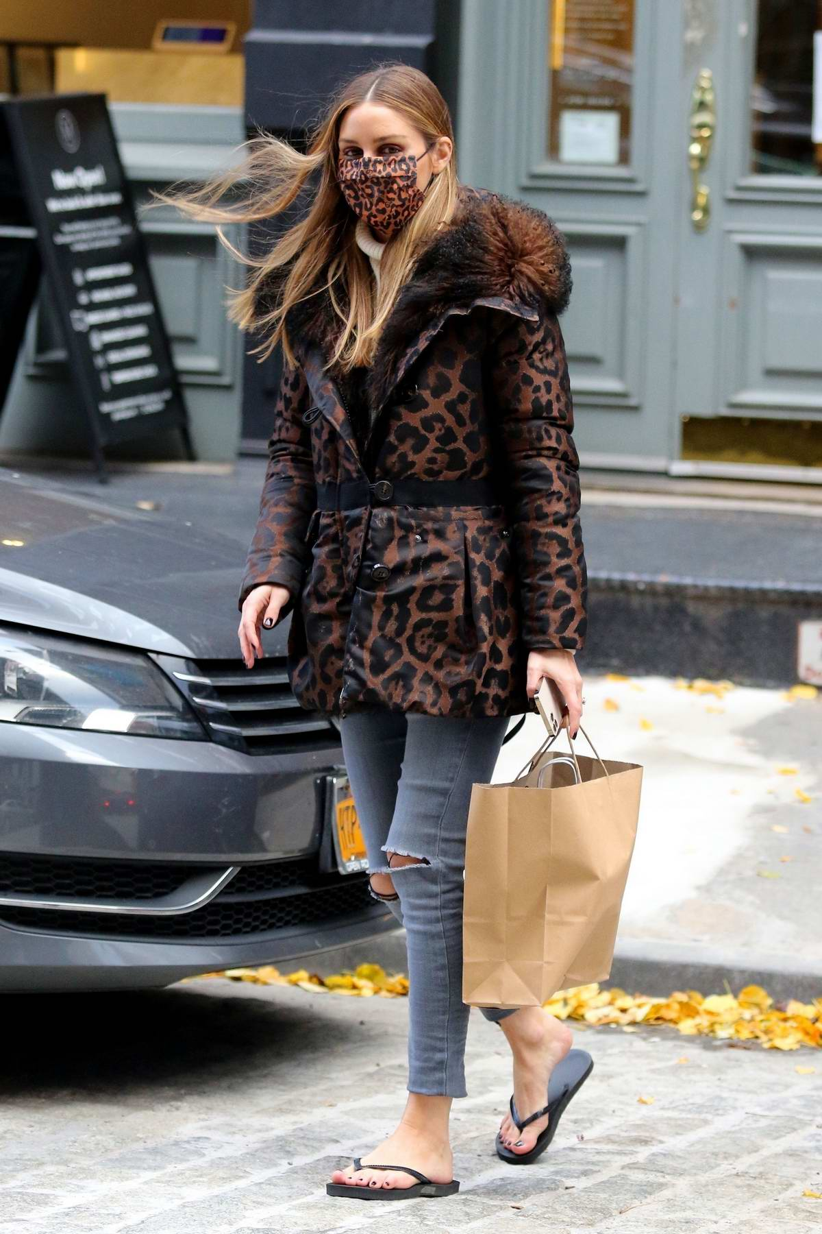 Olivia Palermo puts on a stylish display in an animal print jacket as she steps out for a pedicure on a windy day in New York City