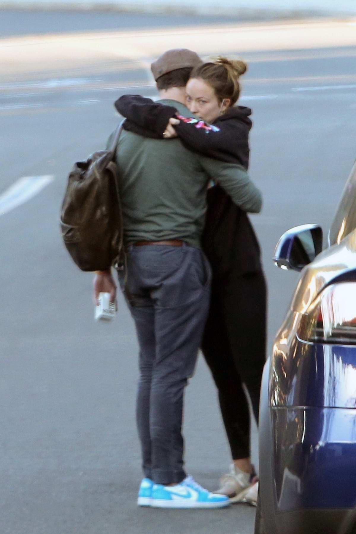 Olivia Wilde and Jason Sudekis share a loving embrace after visiting a Medical Center in Agoura Hills, California
