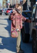 Paris Jackson looks cozy in a flannel shirt and sweatpants as she throws up a peace sign while shopping in Santa Monica, California