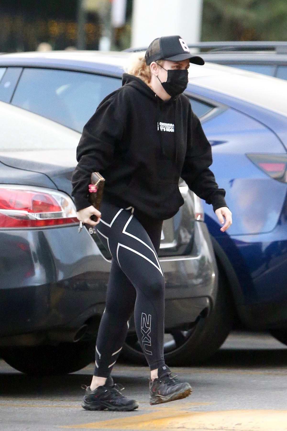 Rebel Wilson sports a hoodie and leggings while picking up groceries at Gelson's in Los Feliz, California