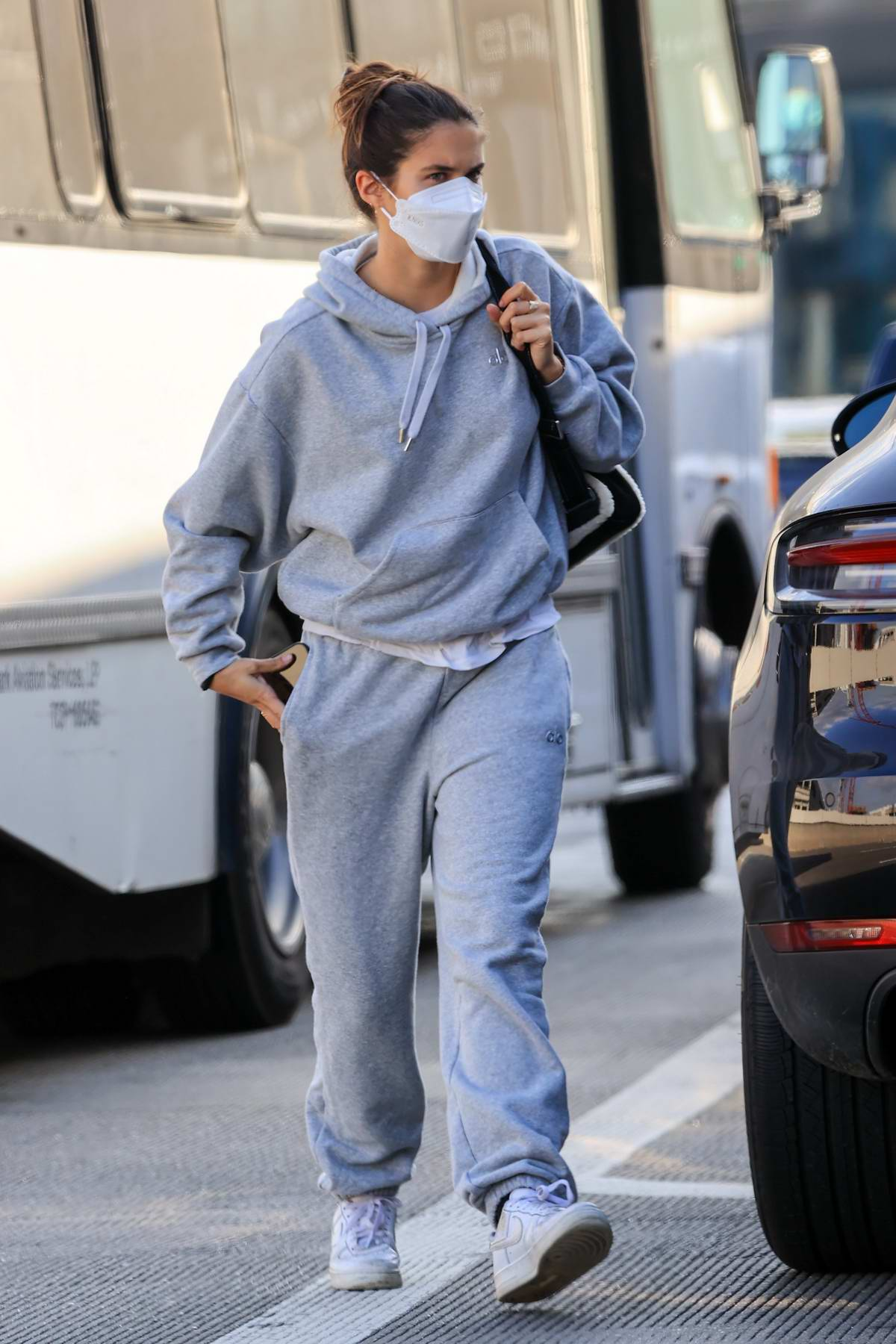 Sara Sampaio looks comfy in grey sweats as she arrives to catch a flight out of LAX in Los Angeles