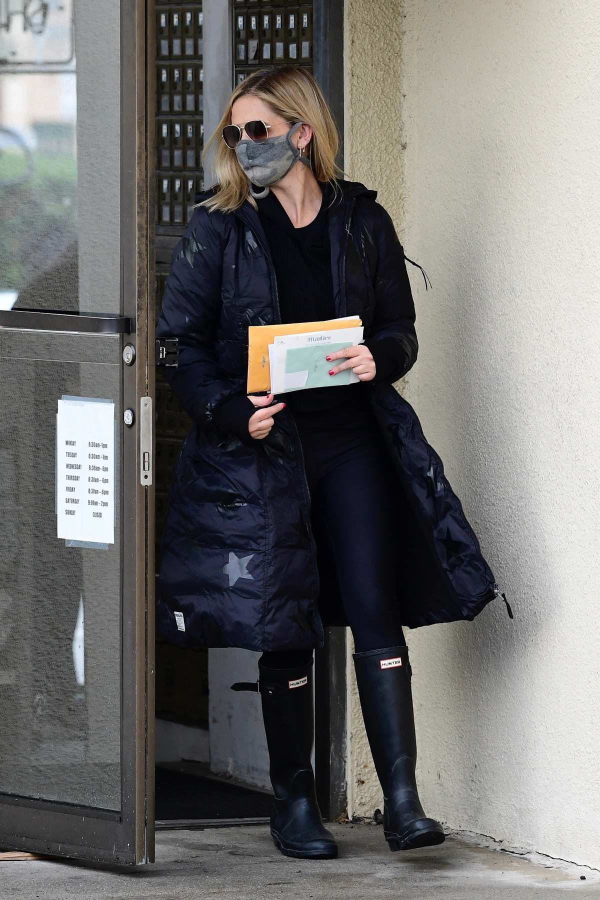 Sarah Michelle Gellar keeps warm in a full-length puffer jacket while making a trip to the Post Office in Brentwood, California
