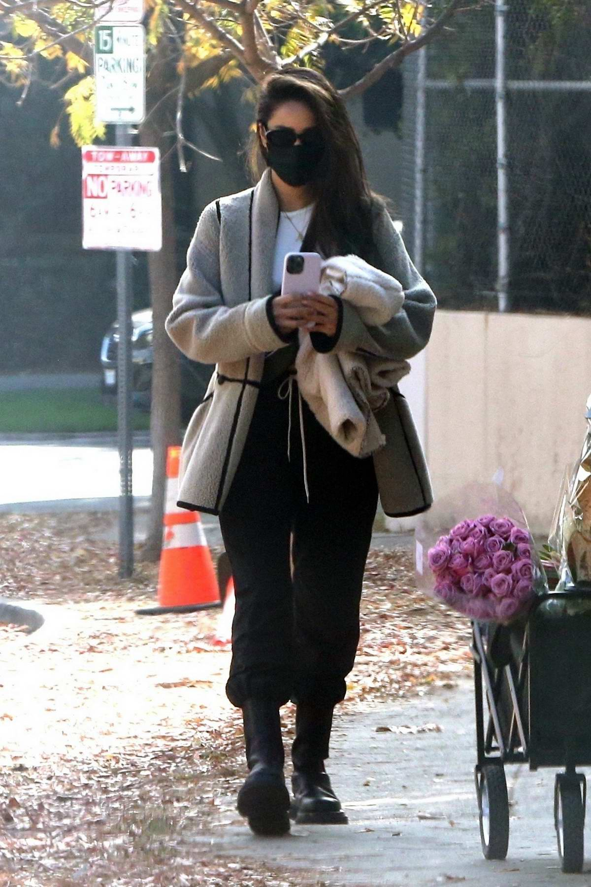 Shay Mitchell takes a walk to the Farmers Market with her family in Brentwood, California