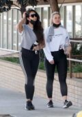 Shay Mitchell wears a grey top and black leggings while out for a power walk with a friend in Hollywood, California