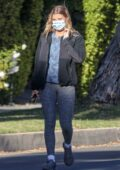 Sofia Richie rocks a black jacket and grey leggings while out for a walk with a friend in Beverly Hills, California