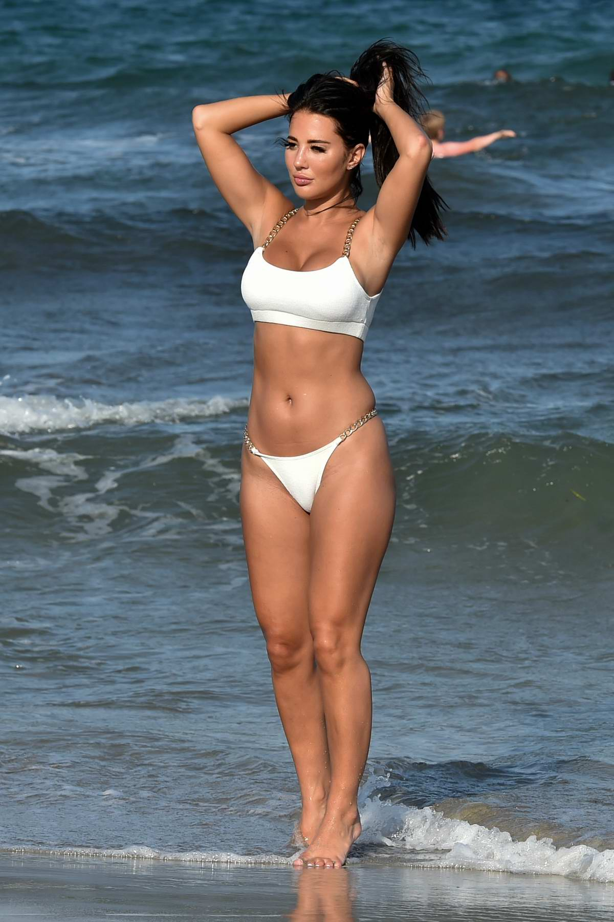 Yazmin Oukhellou shows off her bikini body as she enjoys some time on the beach in Dubai, UAE
