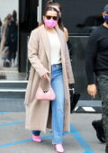 Addison Rae looks classy in a beige coat and jeans as she goes jewelry shopping at XIV Karats in Los Angeles