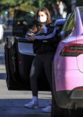 Addison Rae looks sporty in an Adidas jacket with grey leggings as she heads for a workout in Los Angeles