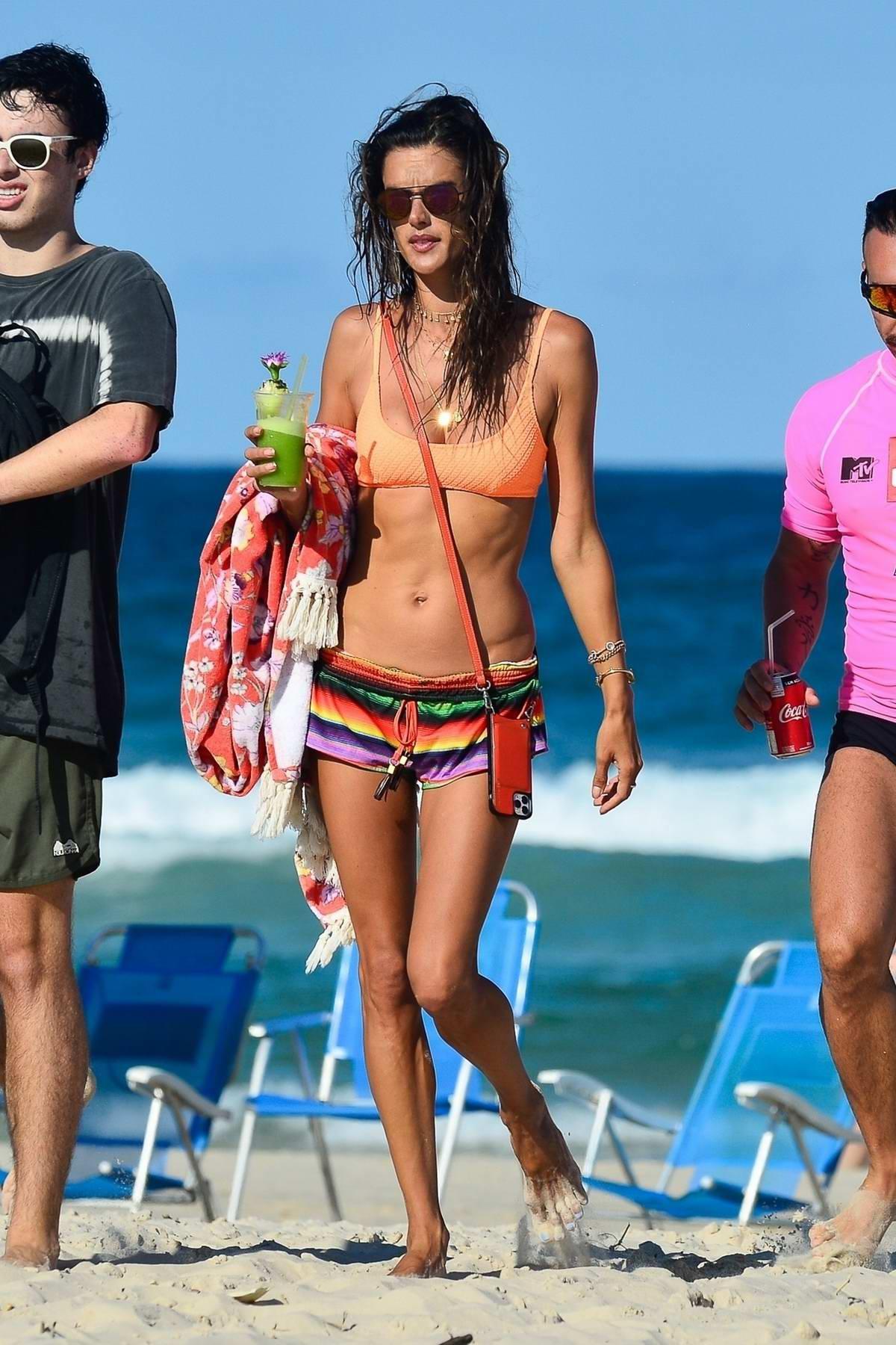Alessandra Ambrosio flaunts her stunning figure in an orange bikini from her swimwear line in Florianopolis, Brazil