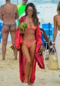 Alessandra Ambrosio looks flawless in a coral pink bikini as she enjoys another beach day in Florianópolis, Brazil