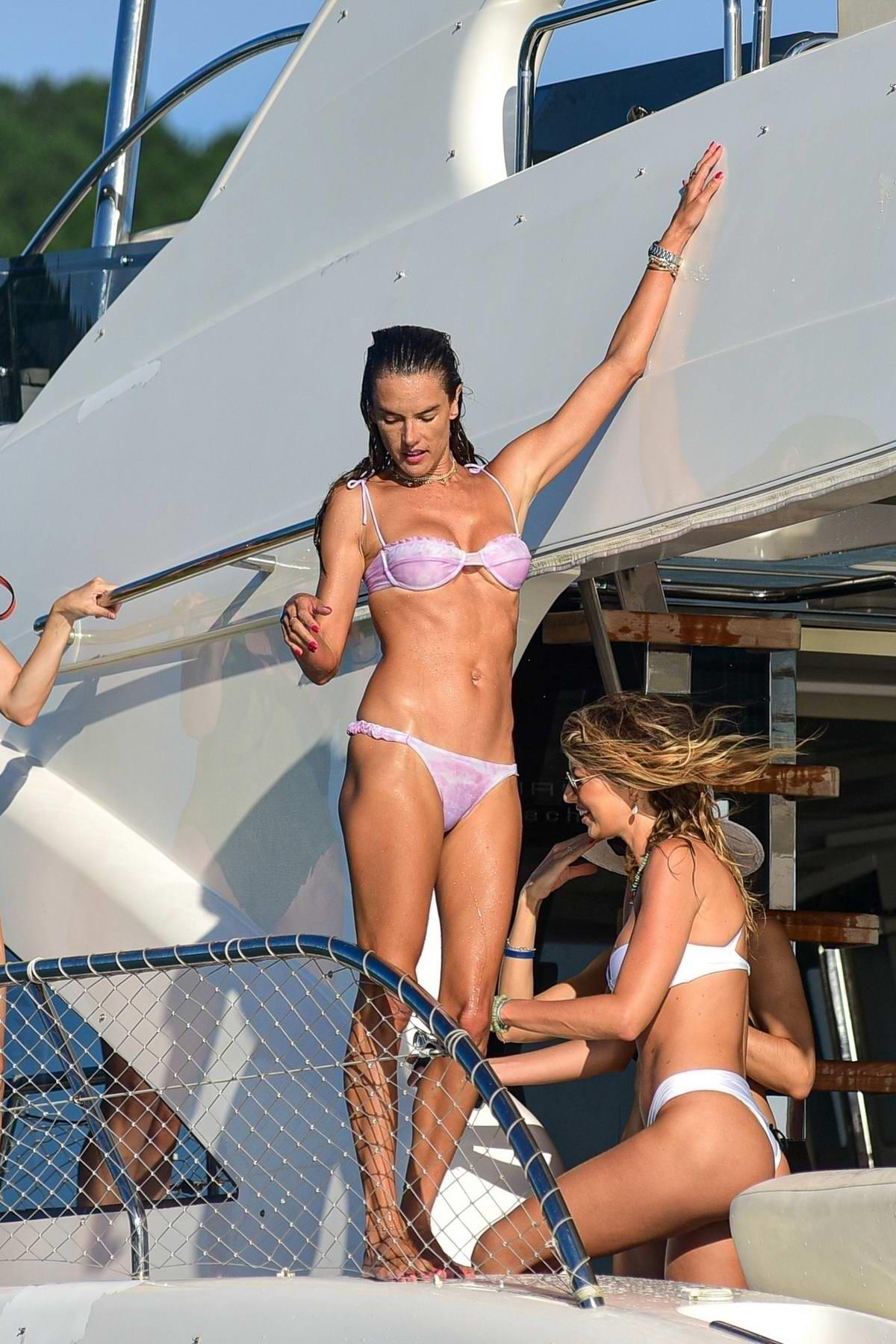 Alessandra Ambrosio showcases her stunning figure in a purple bikini while enjoying on a luxury yacht in Florianópolis, Brazil