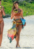 Alessandra Ambrosio stuns in a tan bikini while enjoying a sunny day at the beach with friends in Florianopolis, Brazil