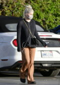 Ariel Winter keeps it comfy in a black sweater and brown baggy trousers while stocking up on groceries in Los Angeles