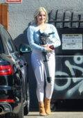 Ariel Winter looks cute in a light blue crop top and white jeans while stopping by a studio in Los Angeles