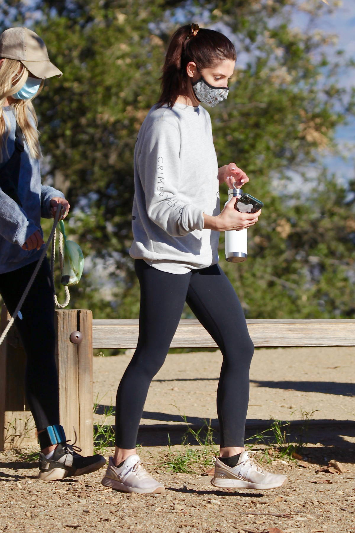 Ashley Greene wears a grey sweatshirt and black leggings for a morning hike with friends in Los Angeles