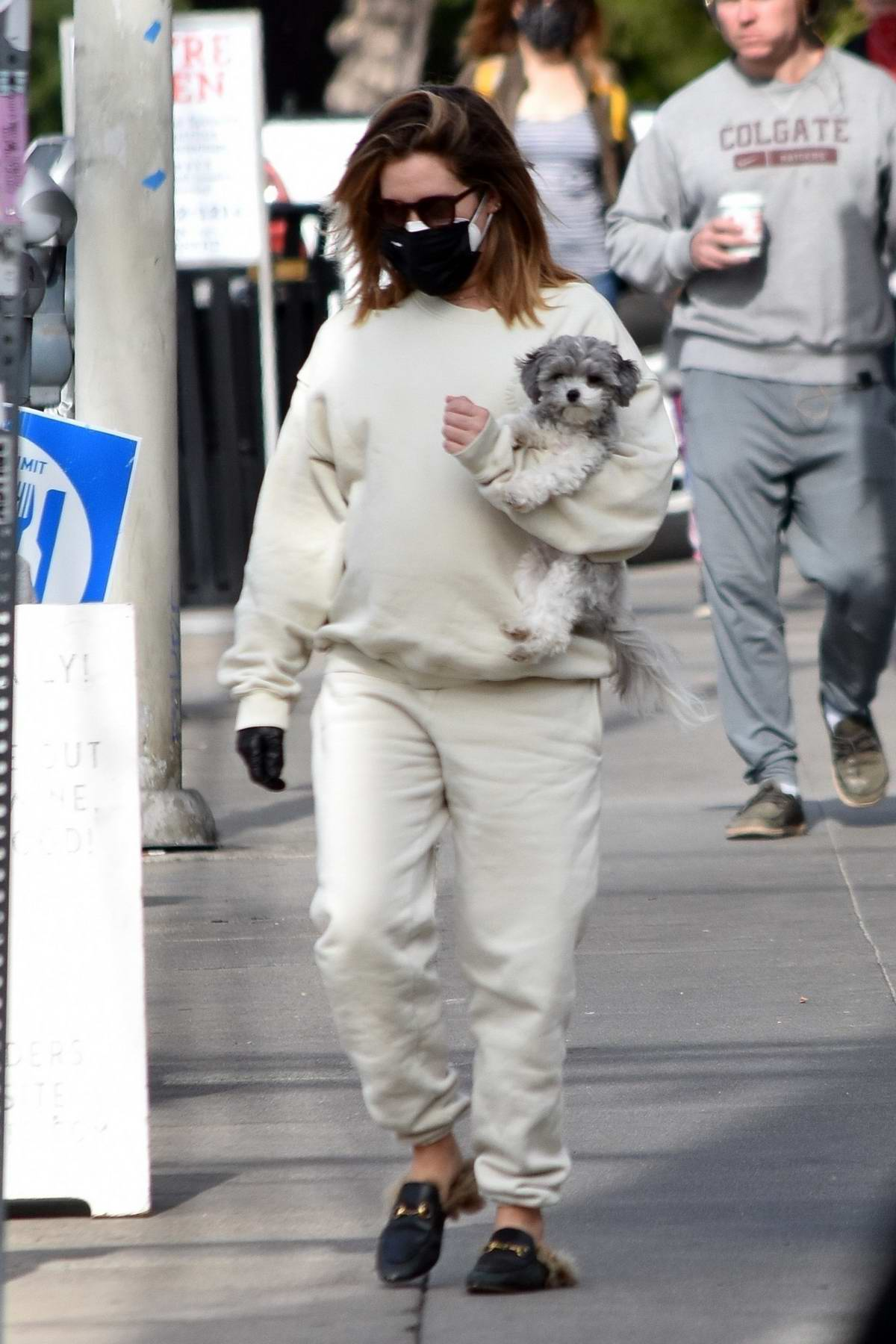 Ashley Tisdale keeps it casual in white sweatsuit to run errands in Los Angeles