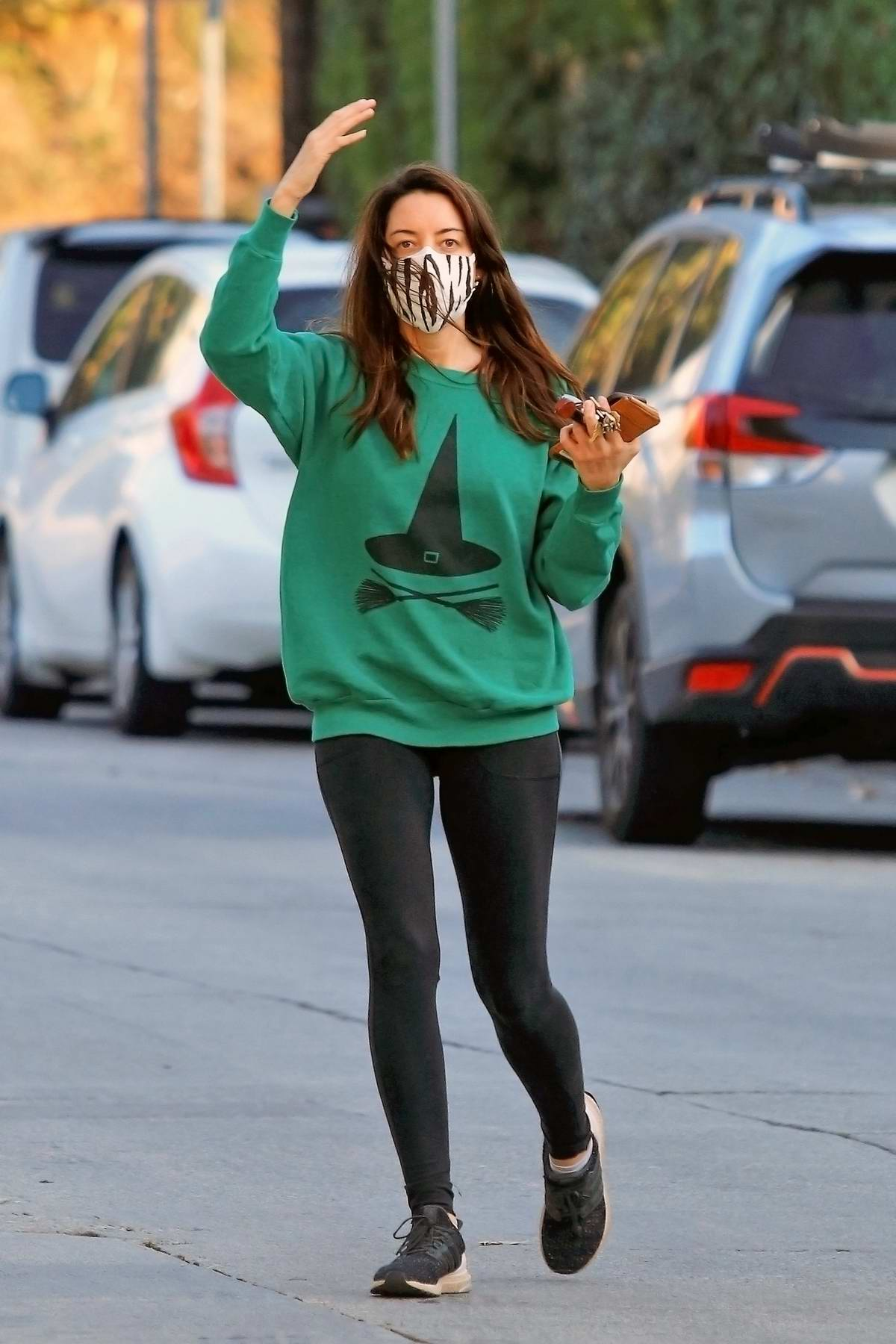 Aubrey Plaza dons a green sweatshirt and black leggings for an outing in Los Angeles
