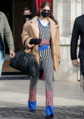 Bella Hadid looks stylish in stripes as she leaves her hotel during Paris Fashion Week 2021 in Paris, France