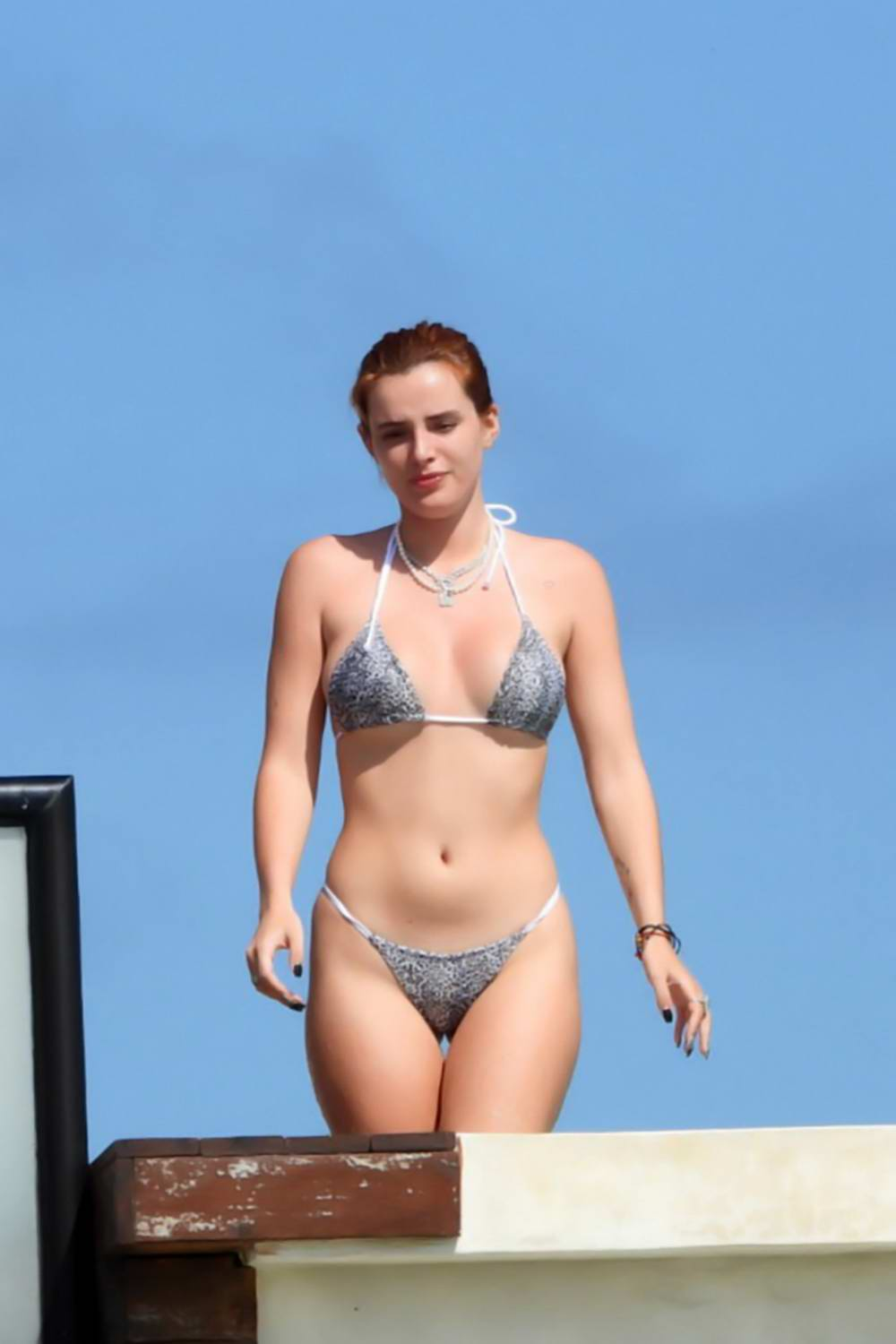 Bella Thorne shows off her enviable figure in a bikini as she relaxes at the hotel pool in Tulum, Mexico