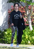 Camila Cabello seen wearing patterned leggings with a black hoodie while out for a solo walk in Miami, Florida