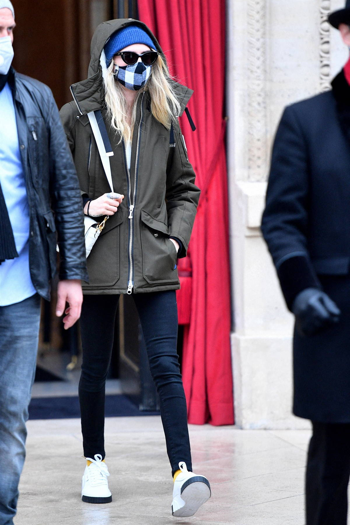 Cara Delevingne keeps it low key as she stops out of La Reserve hotel in Paris, France