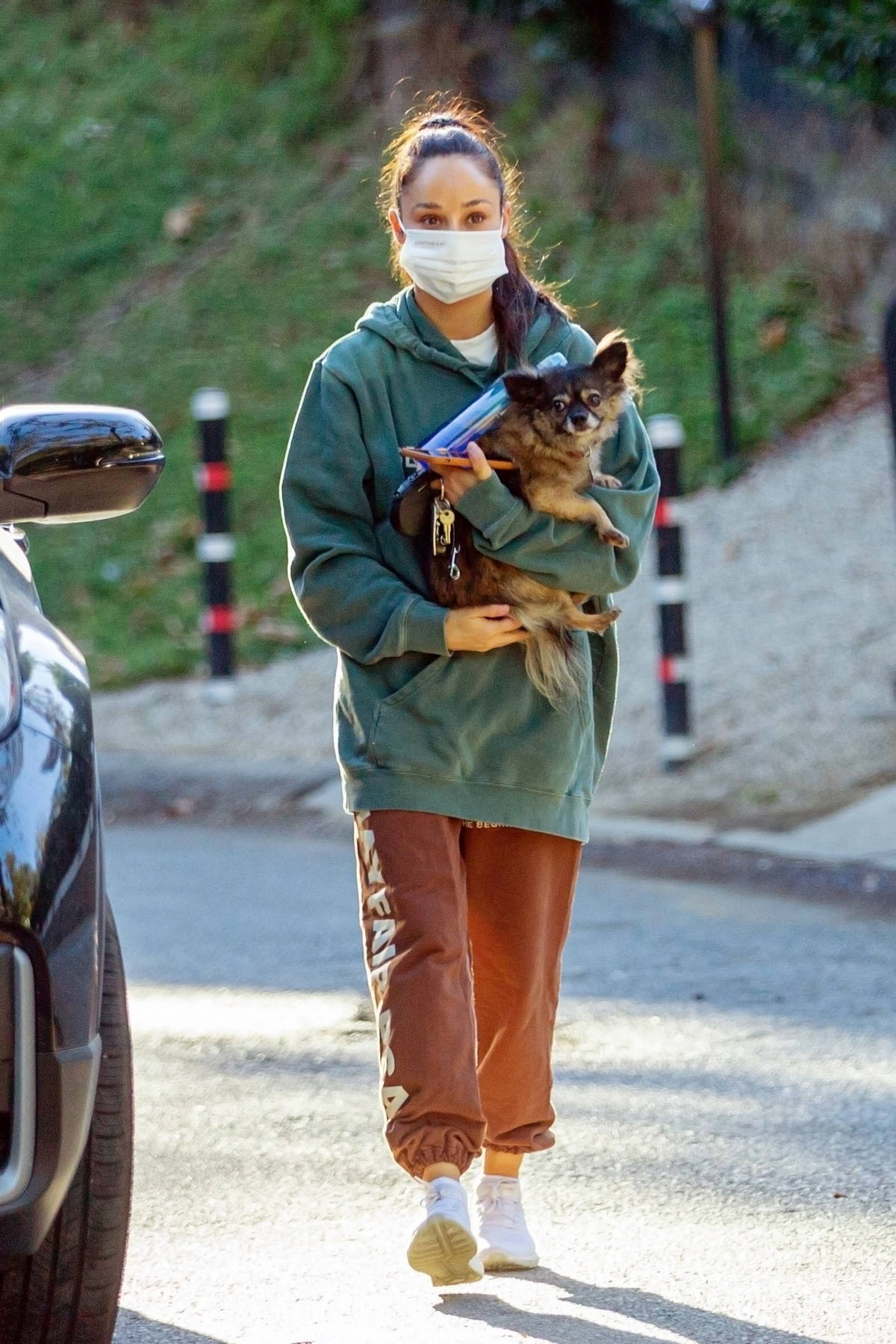 Cara Santana seen carrying her dog while out for a late day hike in Los Angeles