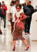 Cardi B showcases her quirky style in a form-fitting sheer dress while out shopping with Offset in Beverly Hills, California