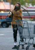 Chantel Jeffries keeps it casual in flannel shirt and tie-dye sweats while picking up some groceries in West Hollywood, California