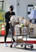 Charlize Theron sports an all-black gym attire as she stops by Bristol Farms for groceries in Beverly Hills, California